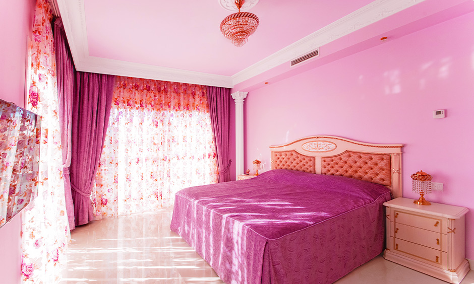 Pink colour bedroom with fall ceiling paint in pastel shades makes it more refreshing to the room.