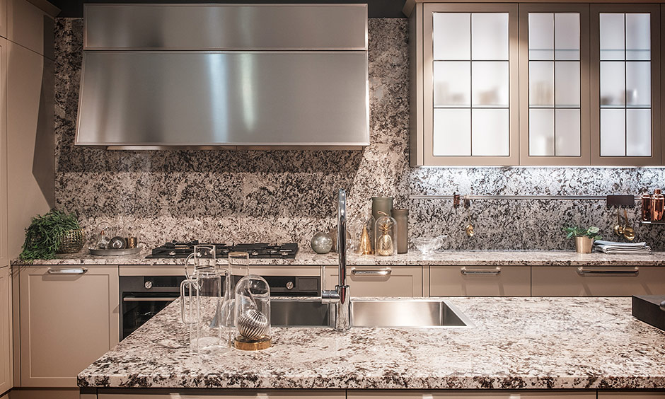 Kitchen granite countertops look beautiful and same granite is also used for the backsplash in the kitchen.