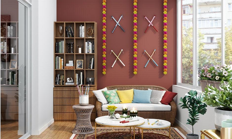 Wall decor with dandiya sticks for dussehra decoration