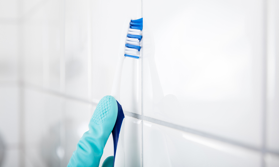 How to clean grout in kitchen wall tiles use of a toothbrush with a mix of baking soda and vinegar.