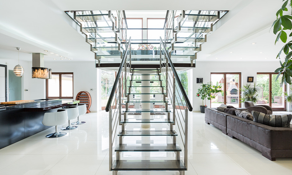 Chic steel staircase design crafted with the interplay of glass
