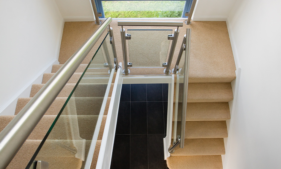 Contemporary stainless steel staircase railing designs in india strikes a perfect balance of form and function