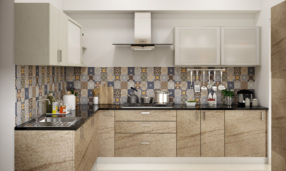 Vitrified tiles used in this kitchen backsplash in Moroccan-styled are the perfect way to the bright and cheerful kitchen.