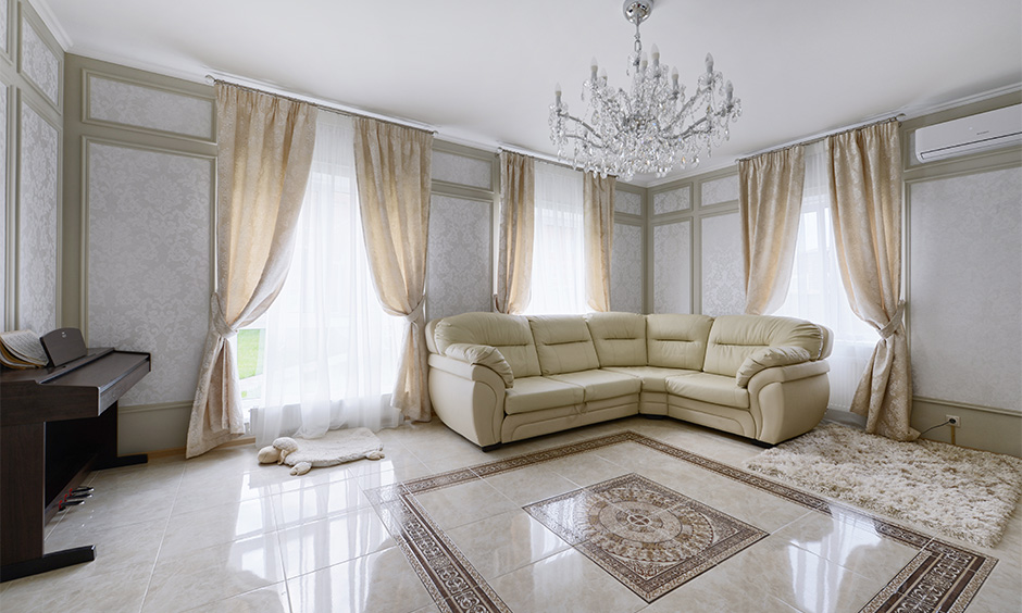 Elegantly designed living room with vitrified tiles offers excellent options in terms of style and patterns.