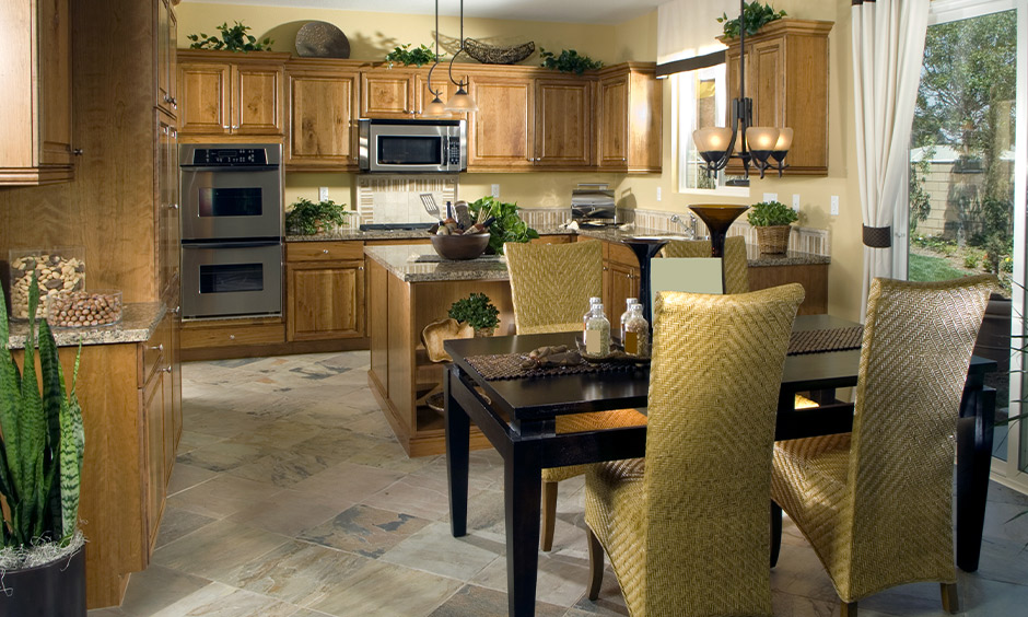 Traditional kitchen with types of vitrified tiles flooring used that brings classic appeal to the area.