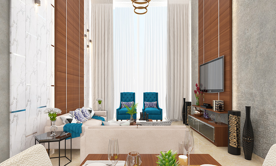 The modern eclectic living room has a unique mismatched colour combination furniture and high ceiling.