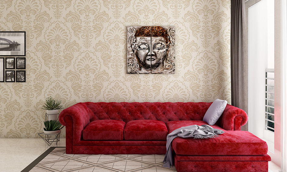 Living room with wallpapers, furnishing and decor made using Indian materials and prints is Indian style interior design.
