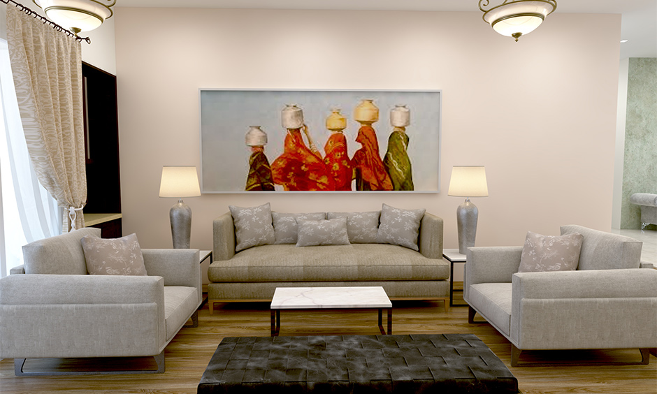 Indian home interior design ideas deck up a wall with Indian art decors like paintings, artwork, and photographs.