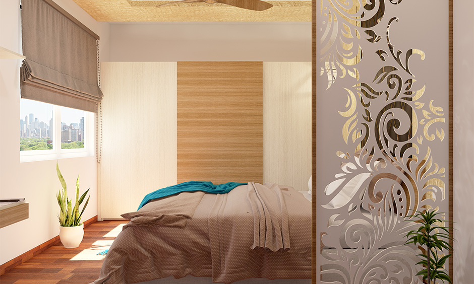 Modern bedroom with jali partition in simple Indian interior design style adds a touch of elegance.