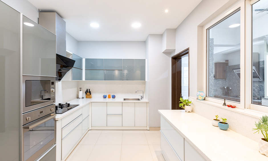 The white kitchen has pure white granite countertops easy to maintain and has an incredible sheen.