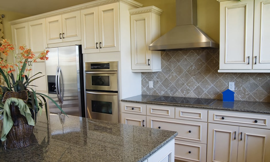 Grey granite countertop with white cabinets