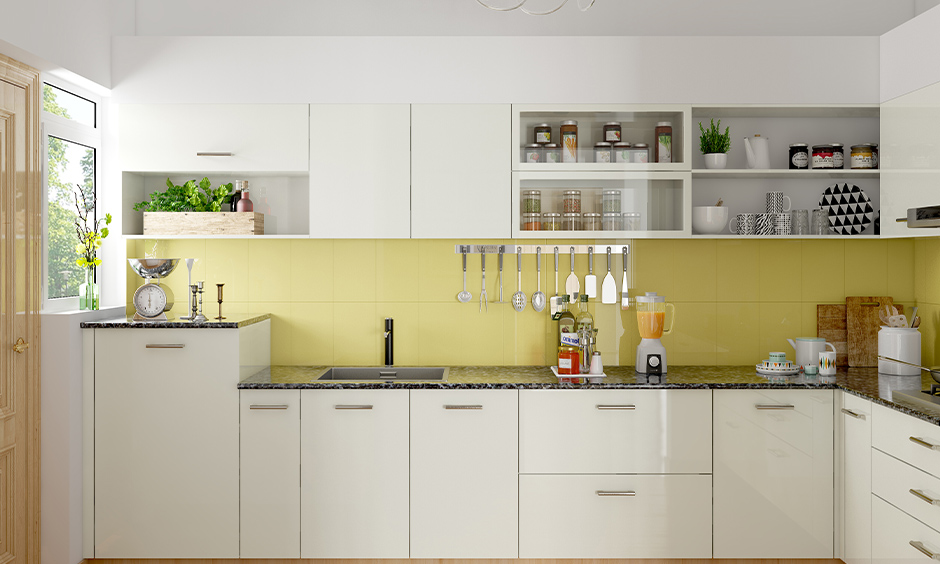 Bright white contemporary painted kitchen cabinets makes this kitchen look bright and fresh