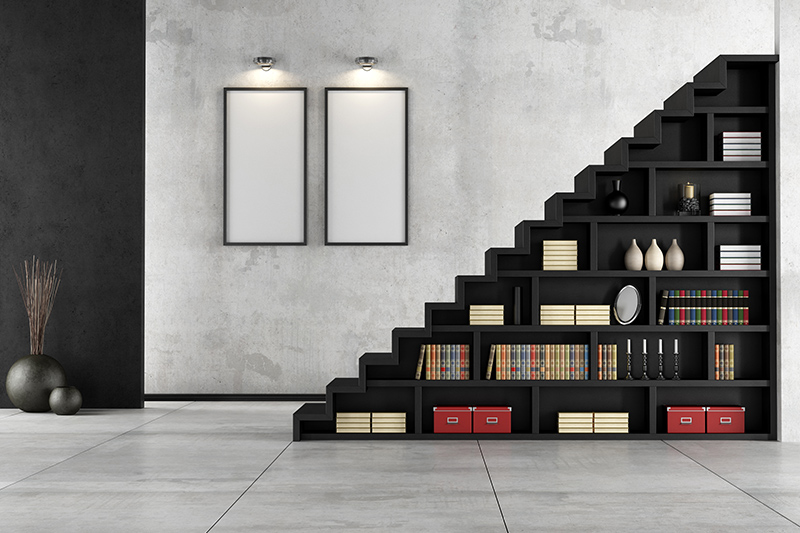 Stairs decoration with a showcase of books underneath the stair is great for clutter-free homes stair decor ideas.