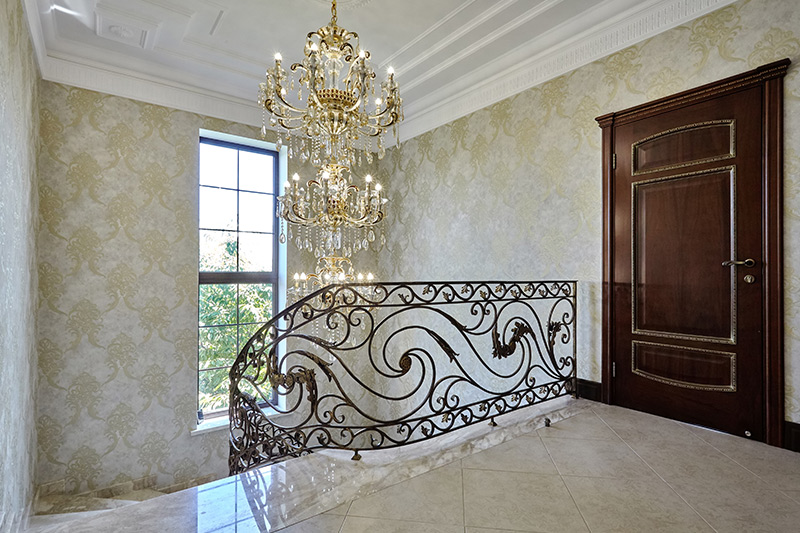 Classic staircase paired with chandelier looks like a palace is how to decorate stairs sleekly.