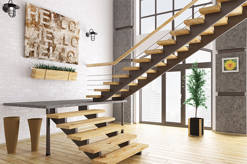 Staircase decorated with artwork and hanging planters look stunning is the top of stairs decorating ideas.