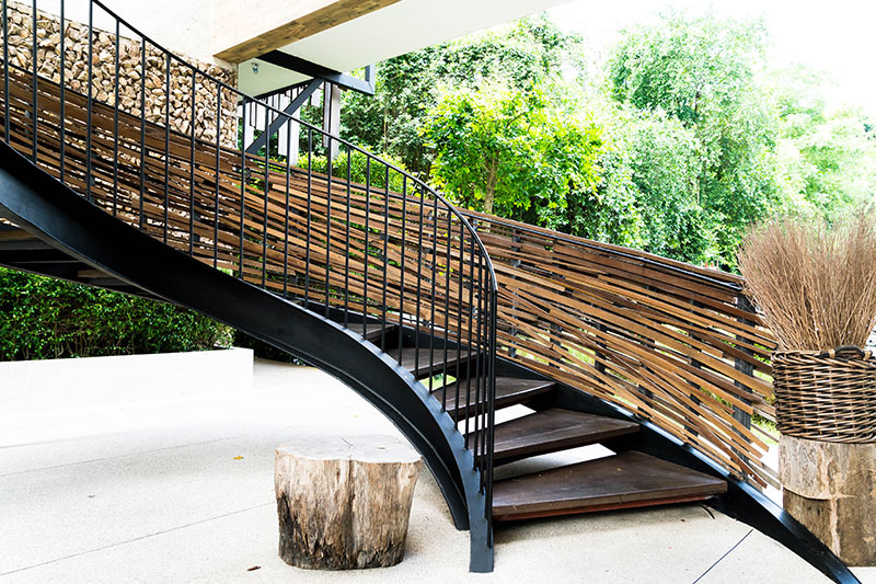 Decorated with wooden stripes by the side of a sweeping staircase are home stairs decoration looks charmed.