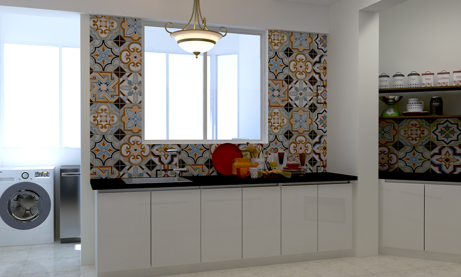 Moroccan tiles with a riot of colours manage to add funkiness to the all-white kitchen is the Moroccan tiles India.