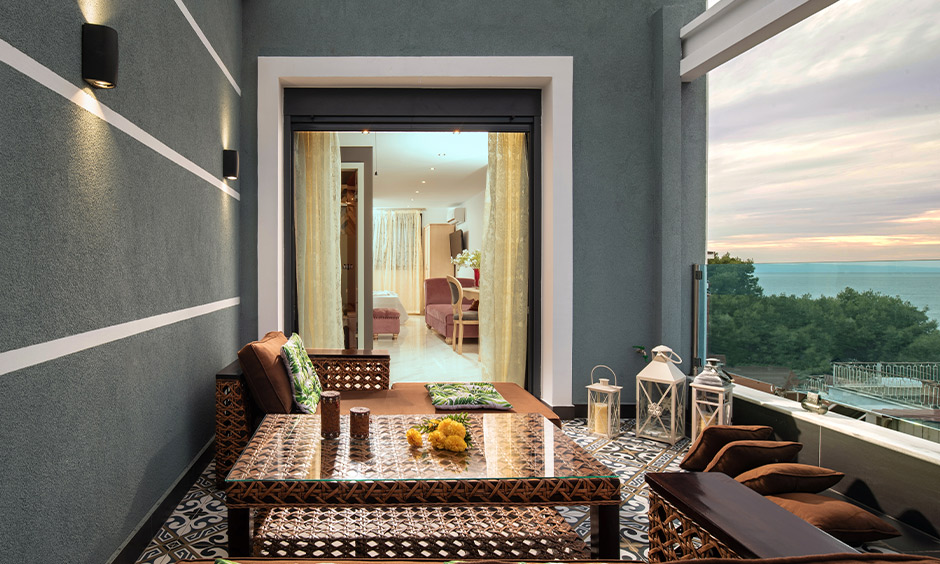 Moroccan tile effect laminate flooring for balcony adds to the perfect set-up to enjoy a chilled out evening at home.