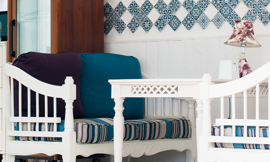 Moroccan tiles patterned are used as wall decor making the corner look strikingly beautiful in the dining area.