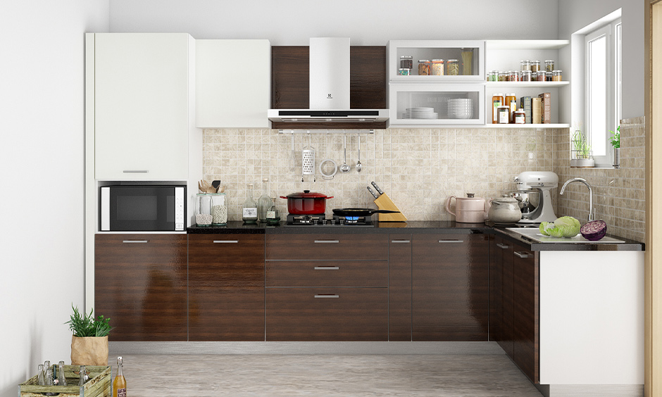 Dark modular kitchen wooden colour which is great for urban families