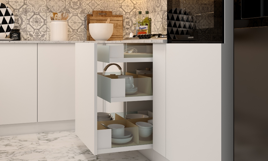 Pull out drawer where all placed crockery and vessels can easily accessed are modular kitchen drawers designs.