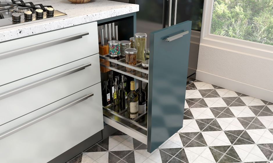 Customised vertical drawer with separators to place the delicate bottles at the right place is smart kitchen drawers.