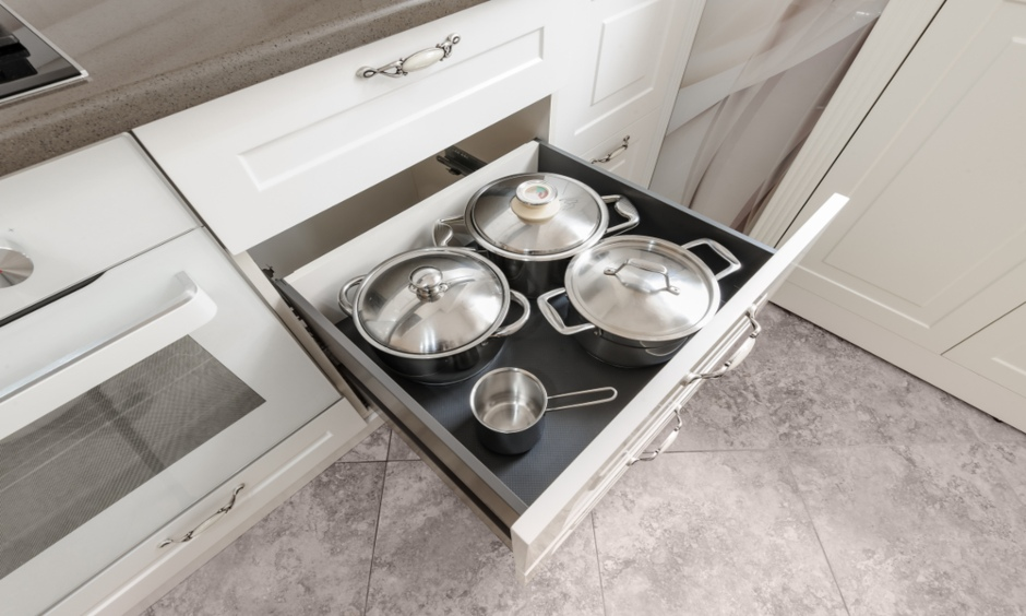 Modular kitchen drawers customised to place larger to fit different sizes of pots and pans as well.