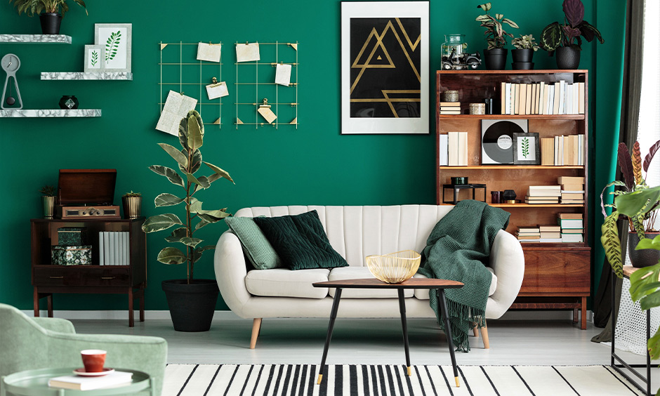 Soft teal paint color for modern living room with cosy beige sofa, antique furniture and home library add charm.