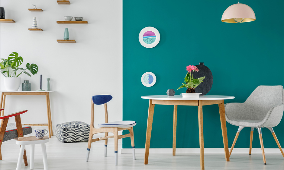 Teal paint colours for the living room perfectly reflect off relax and rejuvenate in style in this minimalistic living room.