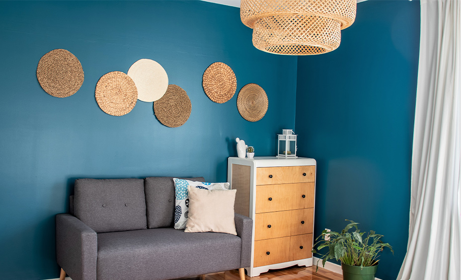 Living room wall with teal paint colour makes the grey couch, wall decor art beautiful is the best dark teal paint color.