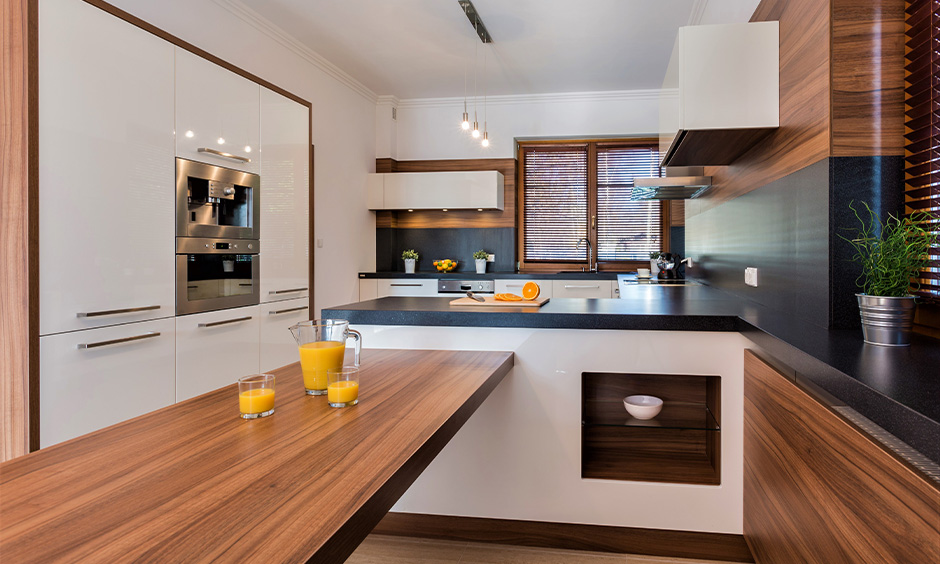 Kitchen with faux-wood laminate countertop brings in a touch of warmth and tradition into the area.