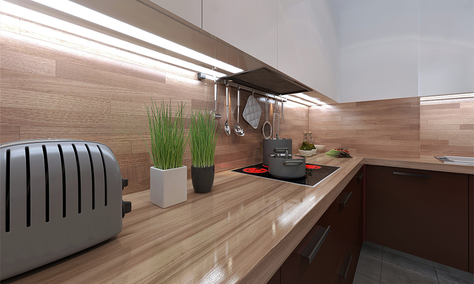 Light brown-shaded laminate countertop designs bring earthy and rich character to the kitchen.
