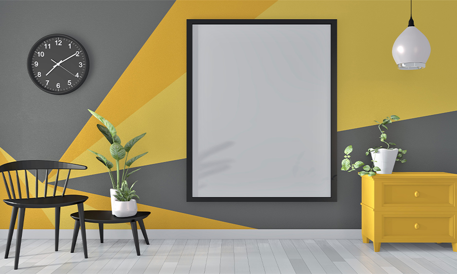Yellow and grey converging triangle wall paint patterns looks mesmerising against the light wooden floor.