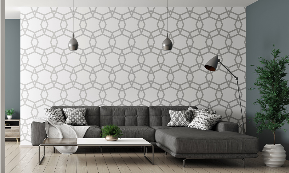 Overlapping octagon wall pattern blends with black corner sofa in the modern living room is geometric wall art painting.