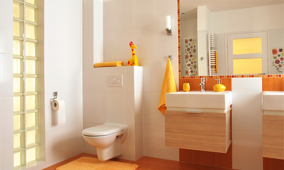 Modern yellow and white-themed kids bathroom with few flower-patterned tiles is kids bathroom wall decor.