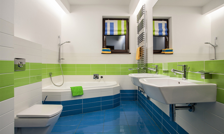 Bathroom in a combination of blue, green and white colours on the wall makes for a perfect boy bathroom idea with bathtub.