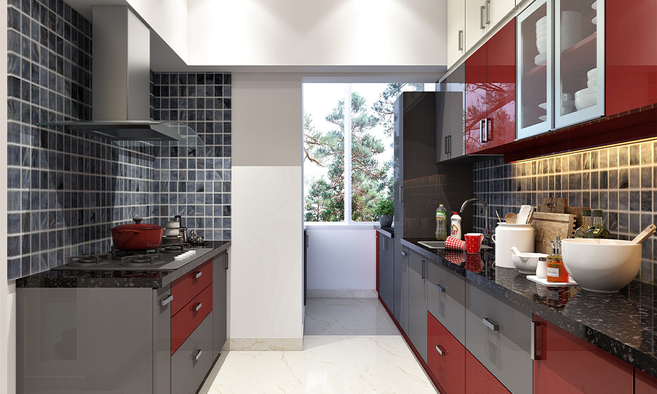 These grey-red Pvc board for kitchen cabinets looks stunning and a perfect match to the black granite kitchen countertop.