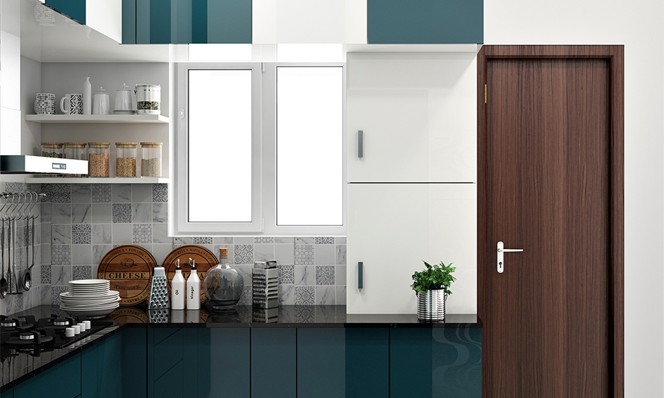 These blue Pvc sheets for kitchen cabinets lend boldness and character to the modular kitchen.