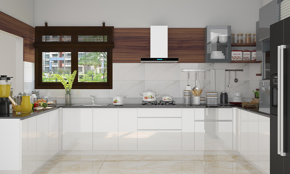 This kitchen with white Pvc kitchen cabinets looks classy is Pvc laminates for kitchen cabinets.