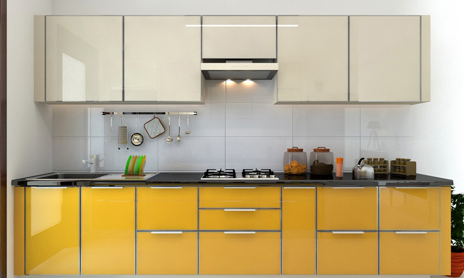 These lower yellow PVC kitchen cabinets in one wall kitchen are long-lasting and resistant to termites look adored.