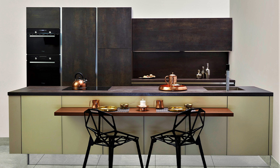 Brownish grey soapstone countertops cost that blends in quite well with the dark brown kitchen cabinets