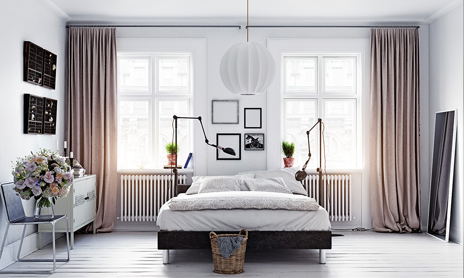 Modern scandinavian interior design bedroom which is elegantly broken by the bed and the other furniture in the room
