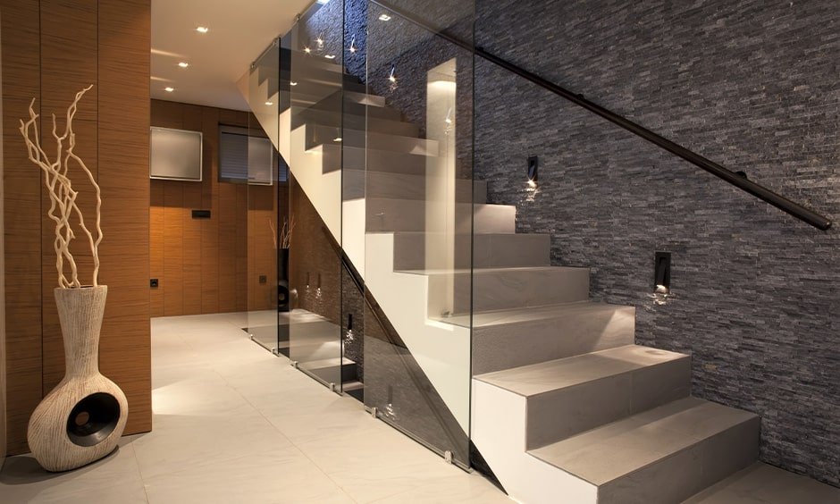 Box-style glass staircase design with ceiling to floor glass panels
