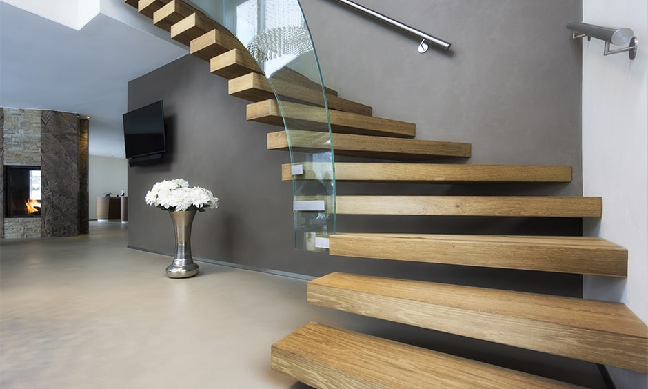 Curved glass railing staircase design for your home