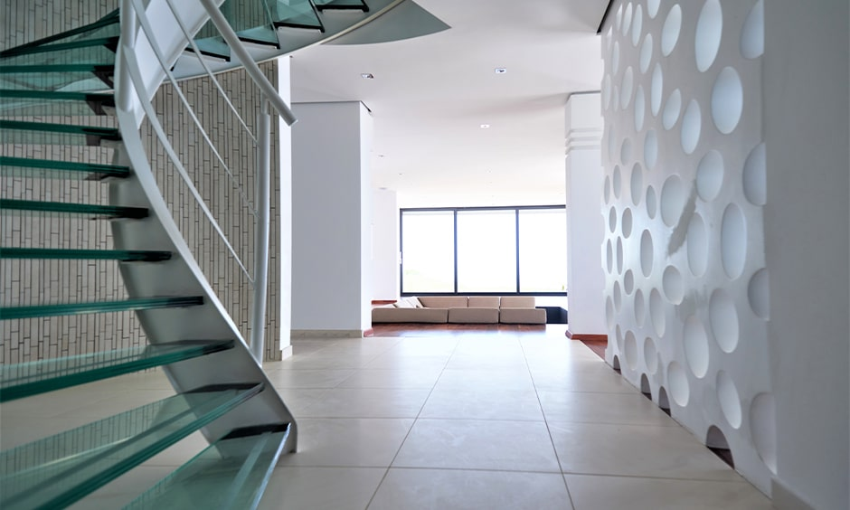 Glass staircase design with metallic handrails for your home