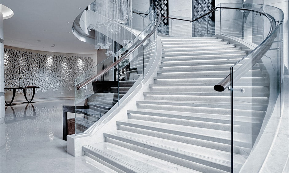 Spiral staircase with glass railing for your home