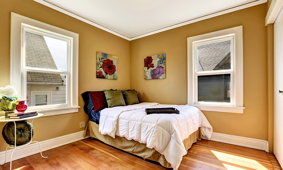 Wall colour combination for small bedroom with a golden brown