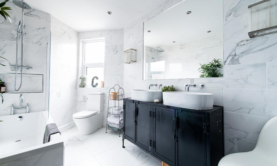 White tiles contemporary bathroom basins above metal knick-knacks and bathtub looks artistic bathroom.