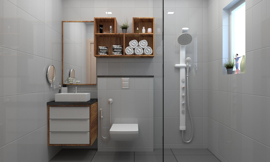 Glass partitioned modern contemporary bathroom design with grey tiles, luxe fittings and chic mirrors.