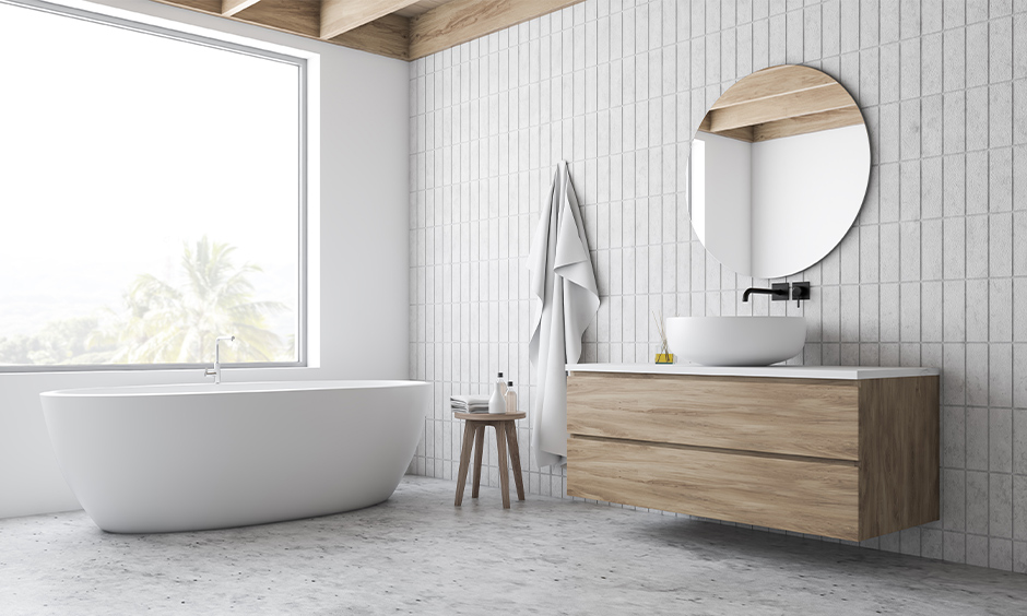 Minimalistic white contemporary master bathroom with a sleek mirror below wooden cabinet and zen bathtub looks seamless.
